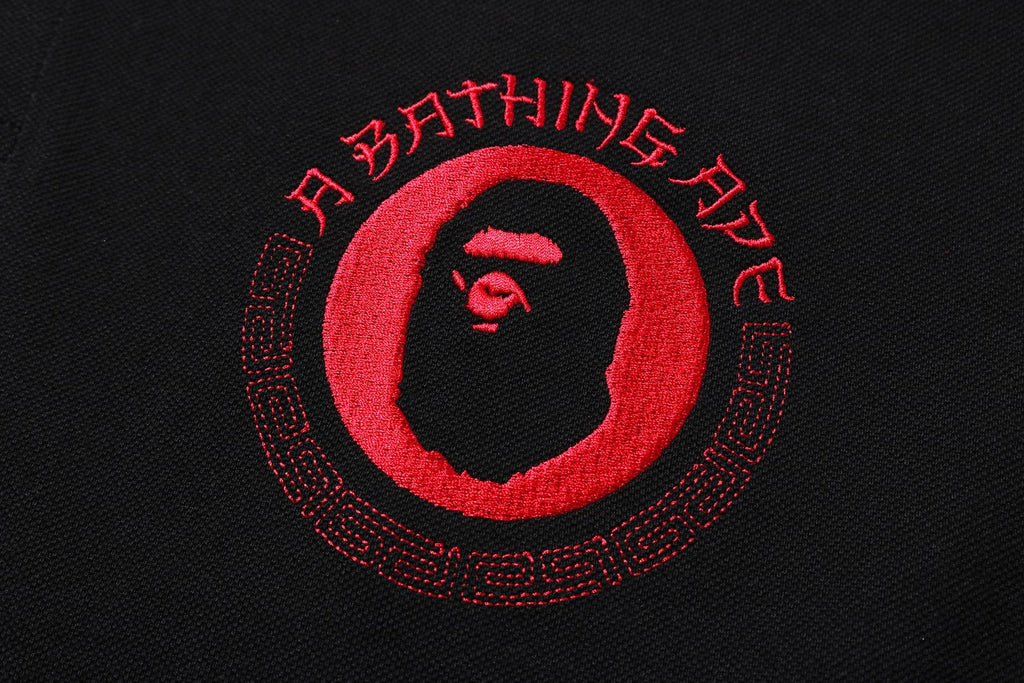 A BATHING APE LETTERED POLO
