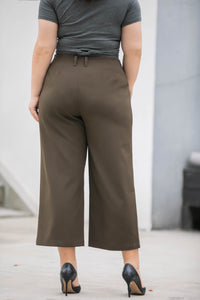 back view of plus size dark green wide legged crop pants