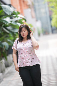plus size pink heart print satin v neck top with peplum