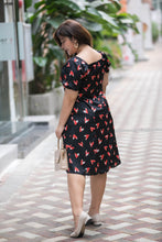 Load image into Gallery viewer, back view of plus size black and red heart print satin midi dress with puff sleeves