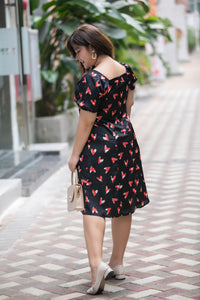 back view of plus size black and red heart print satin midi dress with puff sleeves