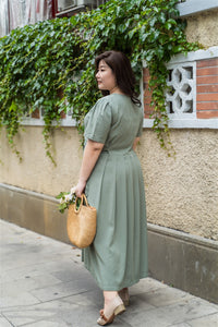 back view of plus size green maxi dress with side ties