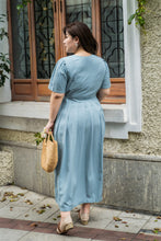 Load image into Gallery viewer, back view of plus size blue maxi dress with side ties