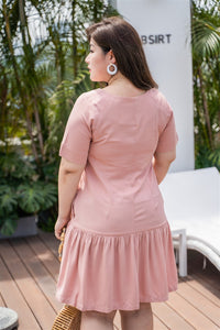 back view of plus size pink drop waist dress