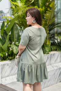 back view of plus size green drop waist dress