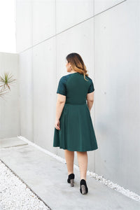 Plus Size Emerald Green Cocktail Dress with Jacquard Sleeves and Inverted Pleats Back View