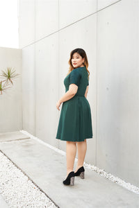 Plus Size Emerald Green Cocktail Dress with Jacquard Sleeves and Inverted Pleats side view