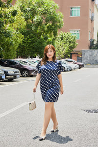 Plus size navy and white polka dot flutter sleeve shift dress
