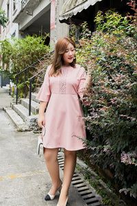 plus size a-line pink dress with bell sleeves and lace detail
