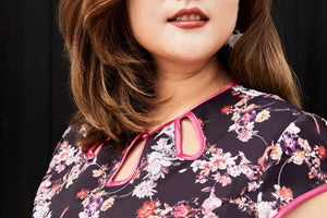 close up of plus size black floral cheongsam qipao inspired fit and flare dress