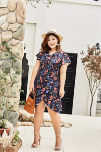 Plus size black floral print faux wrap dress with ruffles