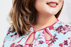 close up of plus size cheongsam qipao inspired dress in blue and pink