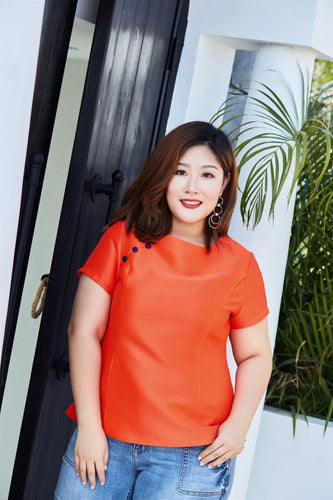 plus size orange top with blue button details
