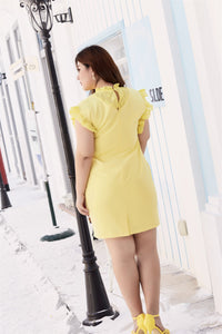 Back view of plus size yellow ruffle neck and sleeve shift dress