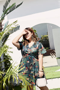 plus size black and green tropical print faux wrap fit and flare dress