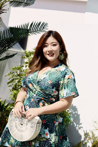plus size blue and green tropical print faux wrap fit and flare dress