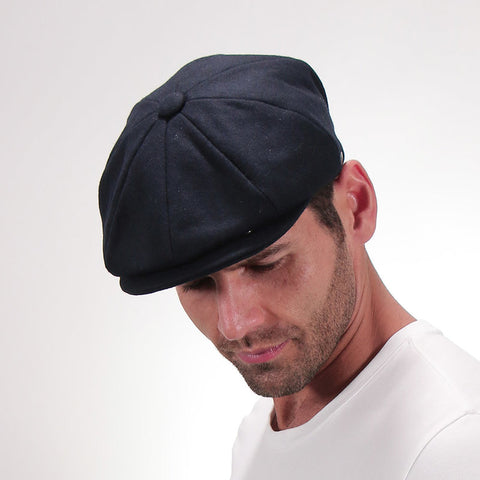 Man in a 8 Panel Newsboy Cap.