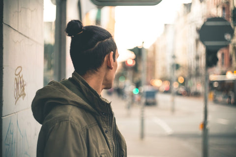 man with topknot