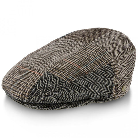 The Irish Flat Cap, with a three-panel desing and tweed pattern, can really enhance your style.