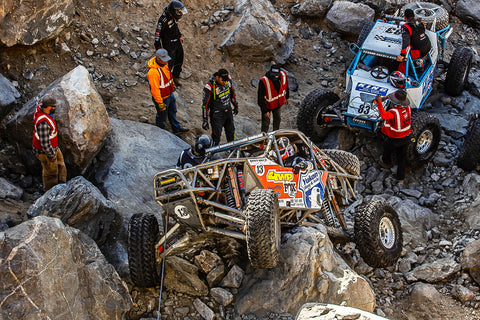Bailey Cole winches over a boulder at King of Hammers