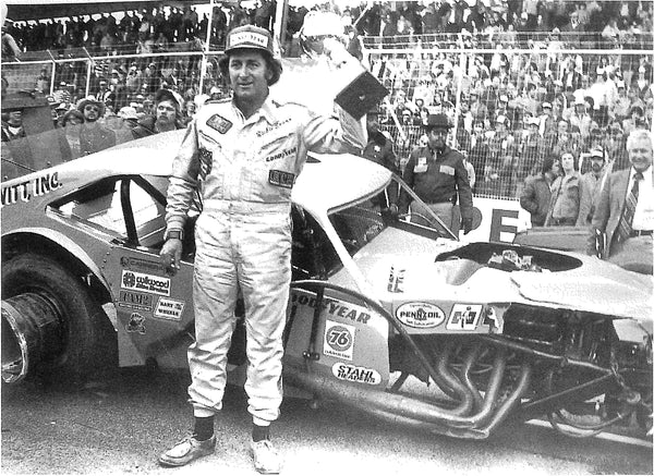 Richie Evans with his wrecked Ford Pinto Modified after winning Martinsville and tangling with Geoff Bodine