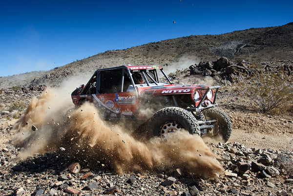 Casey Gilbert's Jeep throws some roost