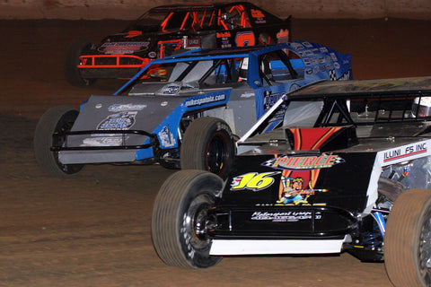 Dirt track racers go into a corner three wide