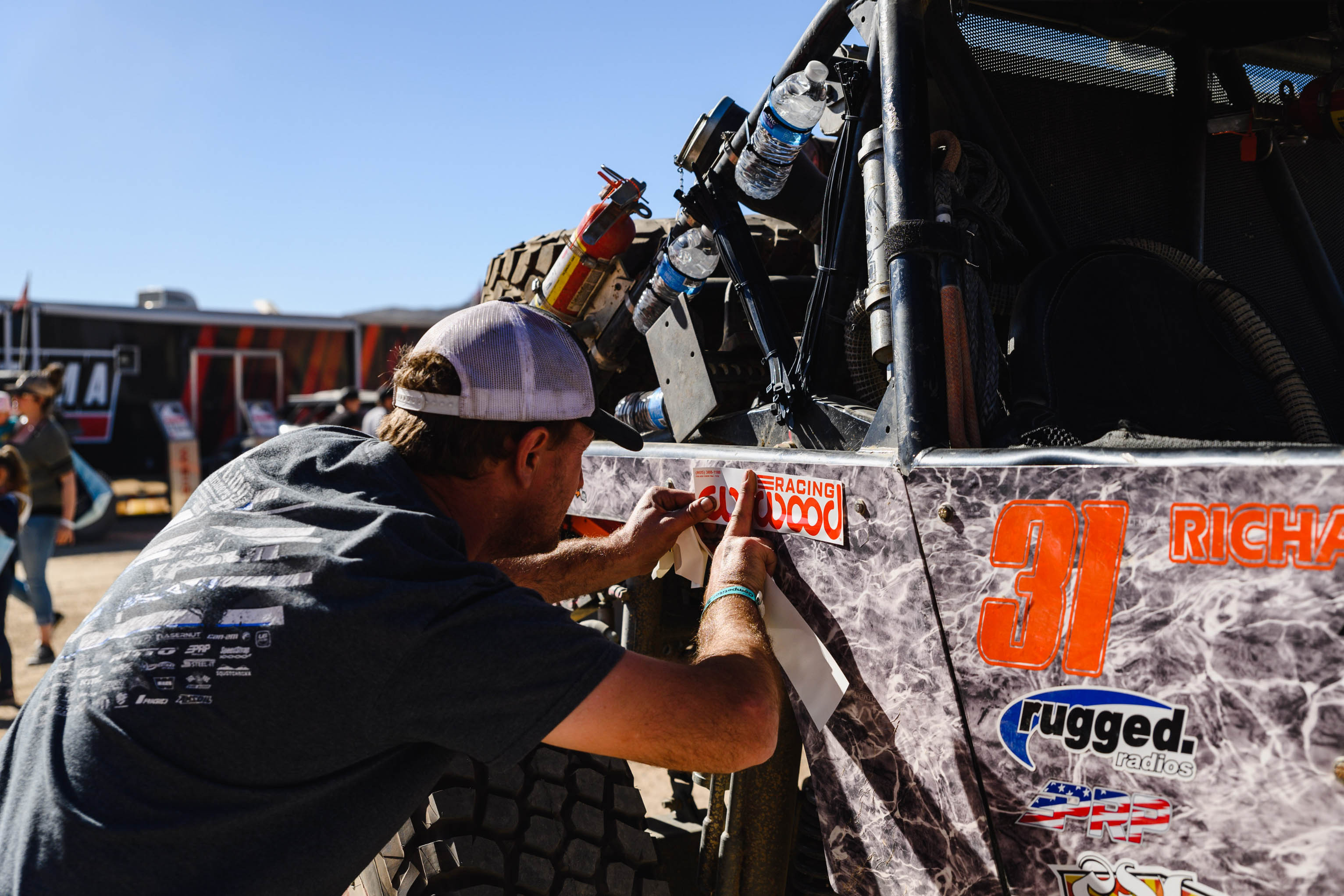 King of Hammer contestent applying Wilwood decal