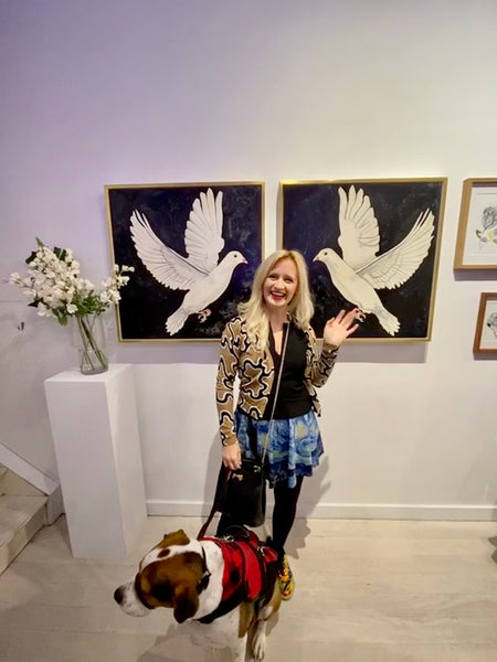 At the Untitled Space Gallery with my watercolor Doves and my dog Davis in January of 2020