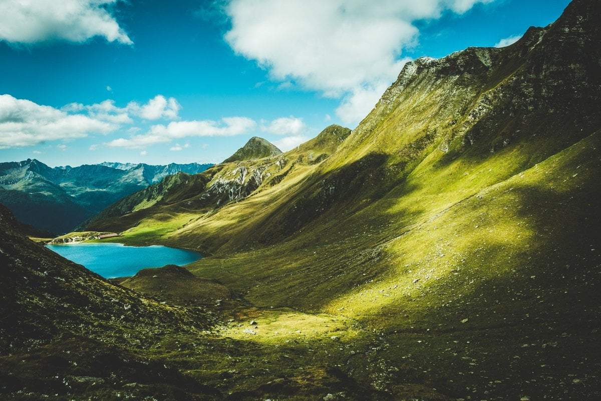 green mountain landscape by a blue lake