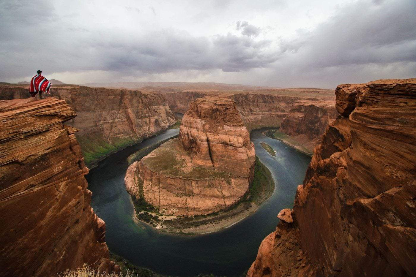 Person looking out at Horseshoe Bend in Grand Canyon, landscape