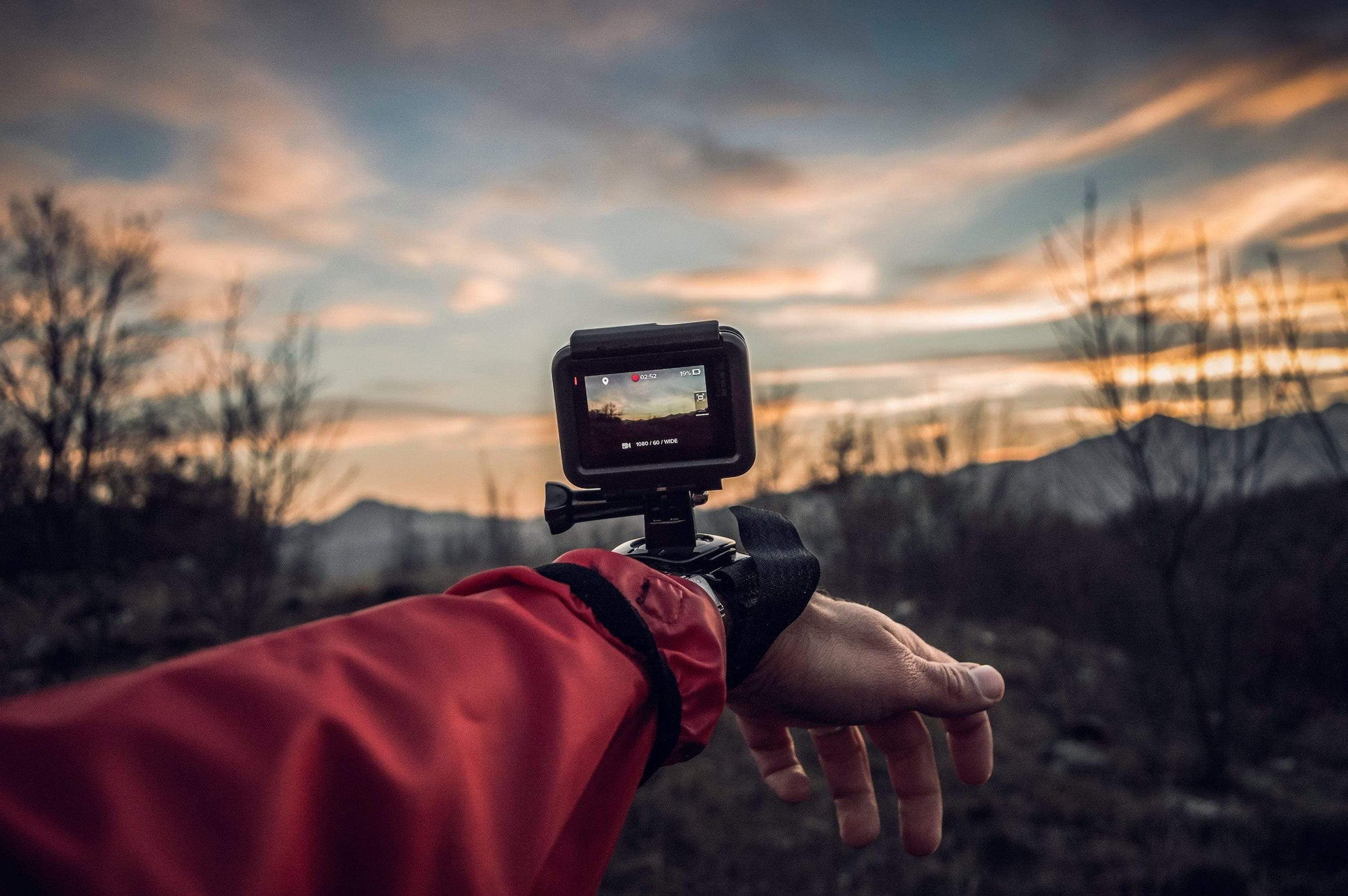 Hand in the outdoors with GoPro on wrist