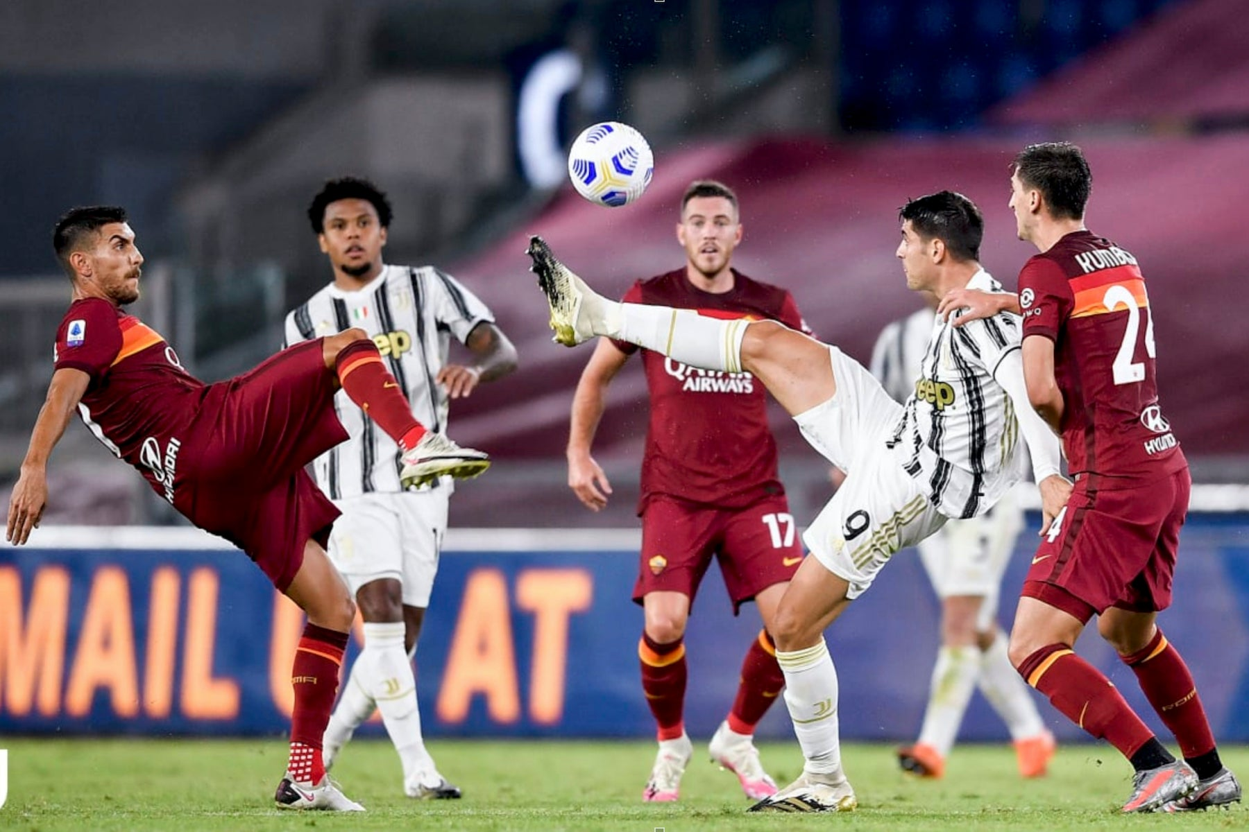 juventus game football players battling for ball red and white uniforms