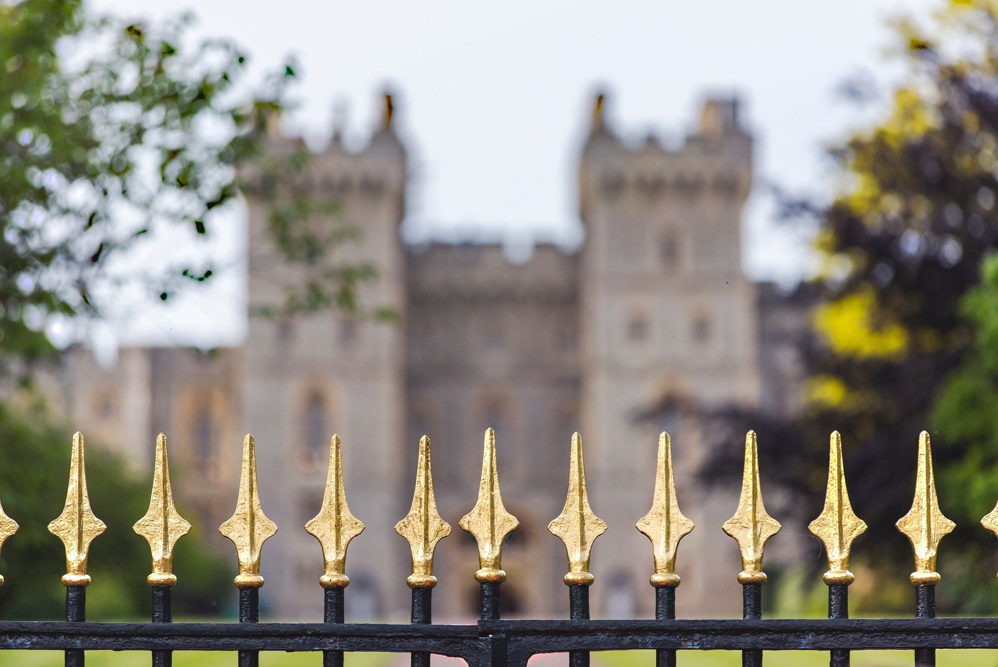 A gold pointy fence in front of King's Church