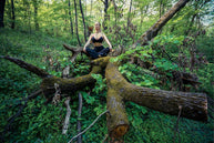woman meditating forest