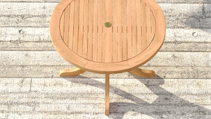 Round teak pedestal table top view