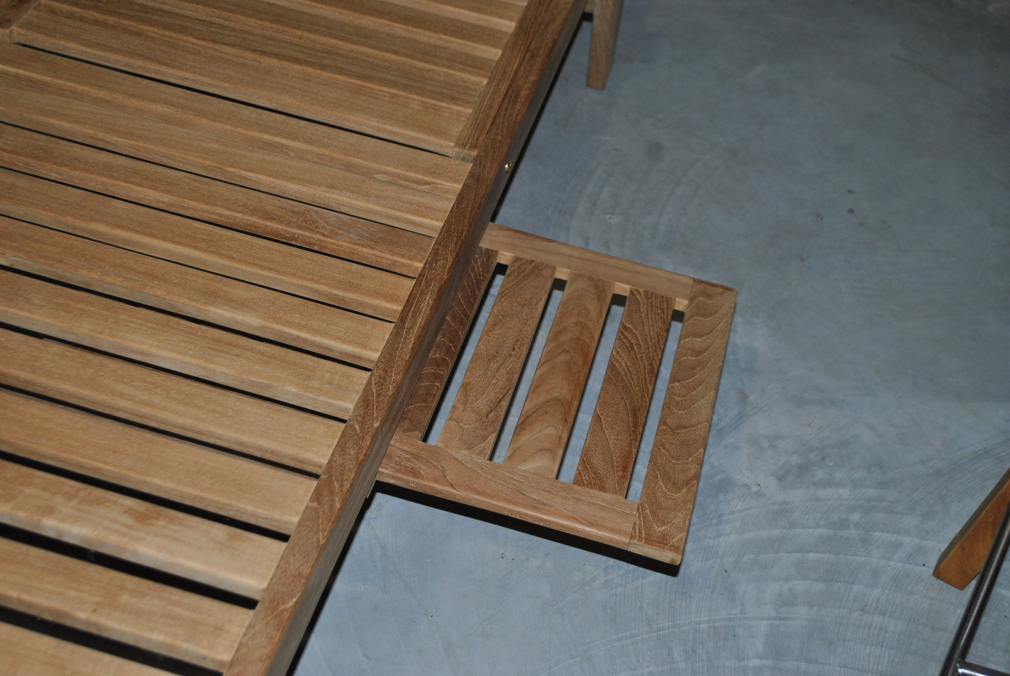 Teak sun lounger with pull out tray close up
