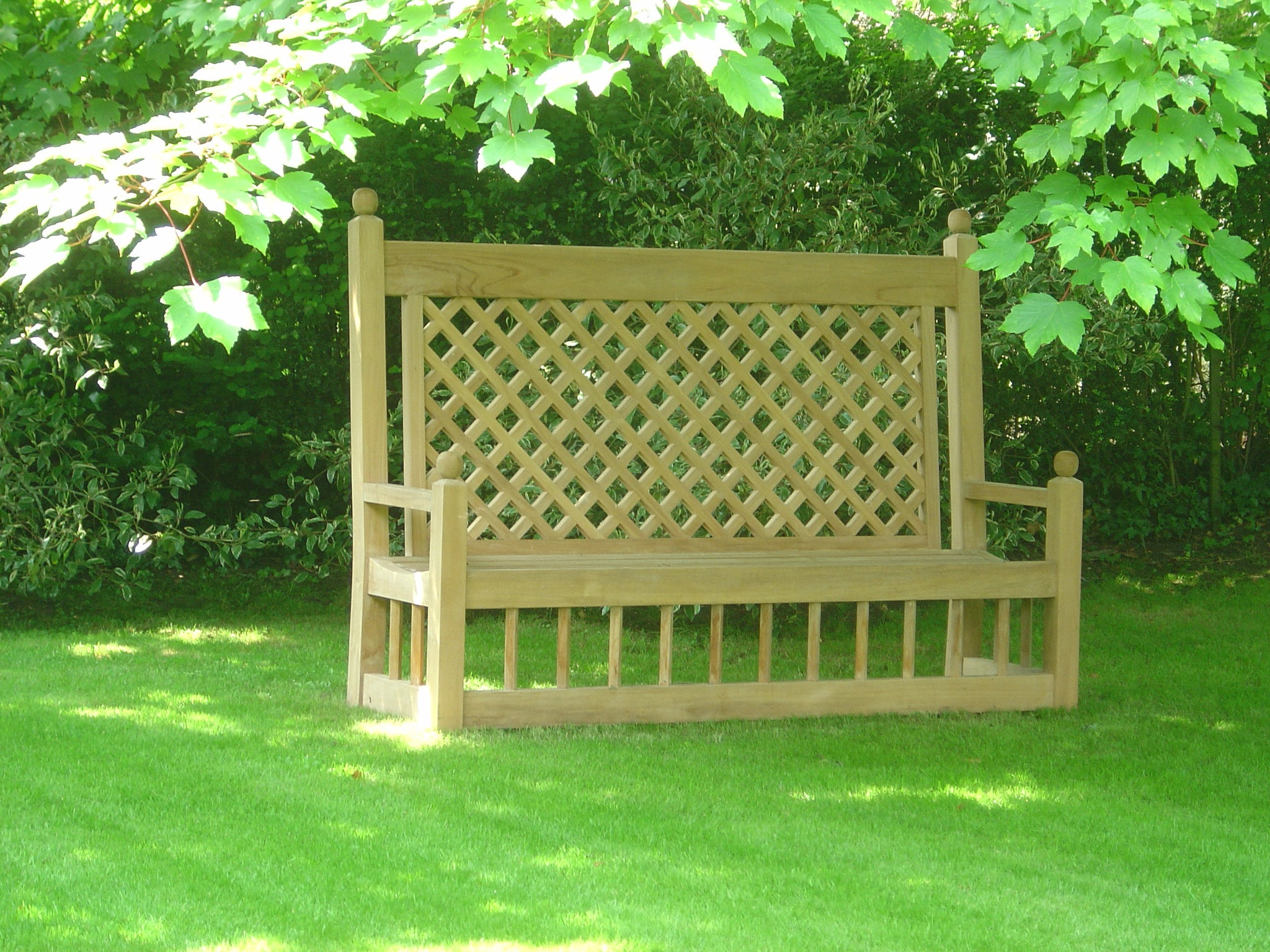 Marden Teak bench in garden