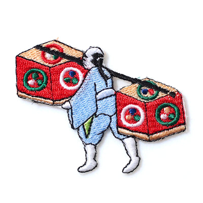 Patch/Man carrying wooden boxes