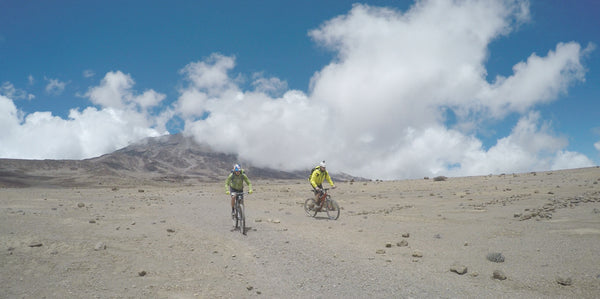 REBECCA RUSH AND PATRICK SWEENEY REACH THE TOP OF THE KILIMANJARO BY BIKE