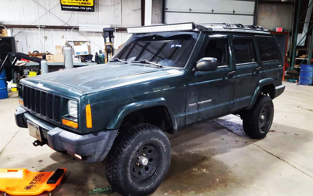 Green Lifted Jeep Cherokee Done Wrong at A Different Shop & Got Fixed At CPW Truck Stuff