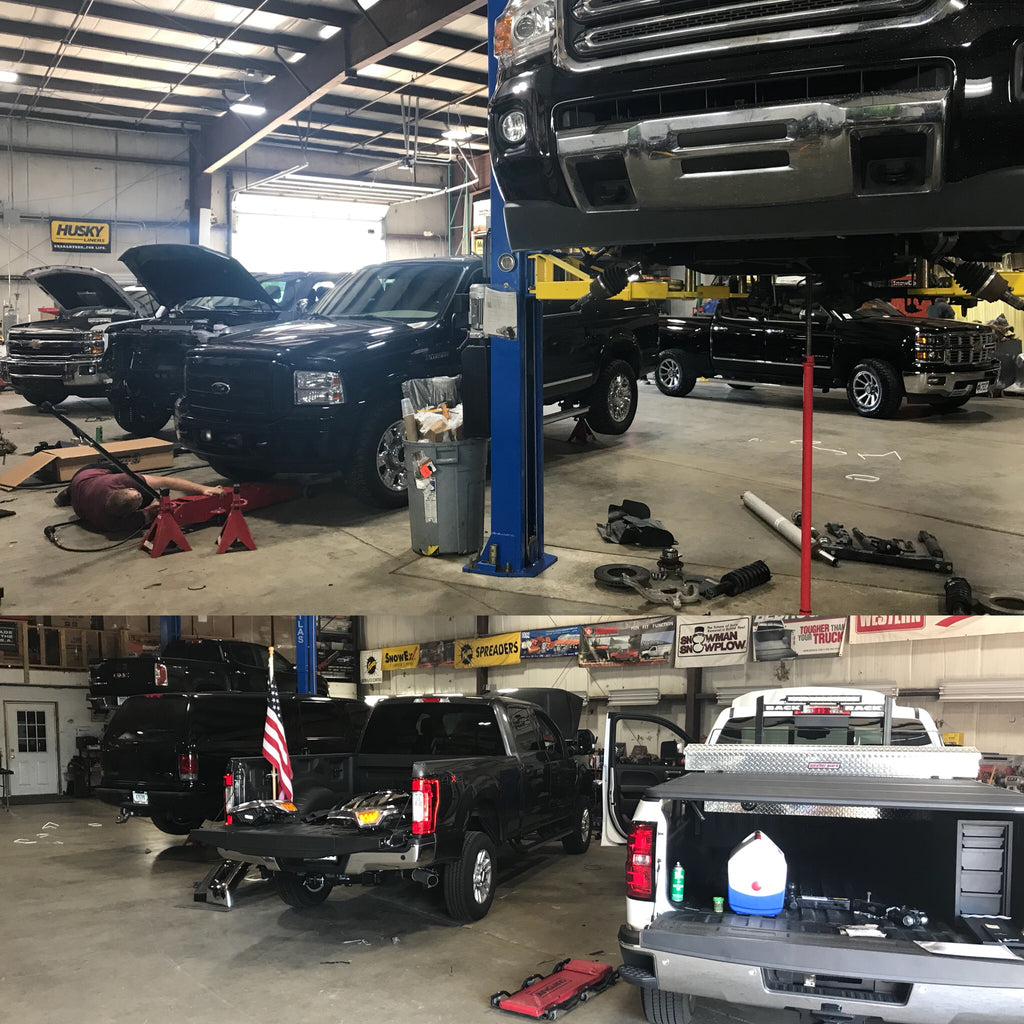 Shop Full of Pickup Trucks Getting Accessories Installed