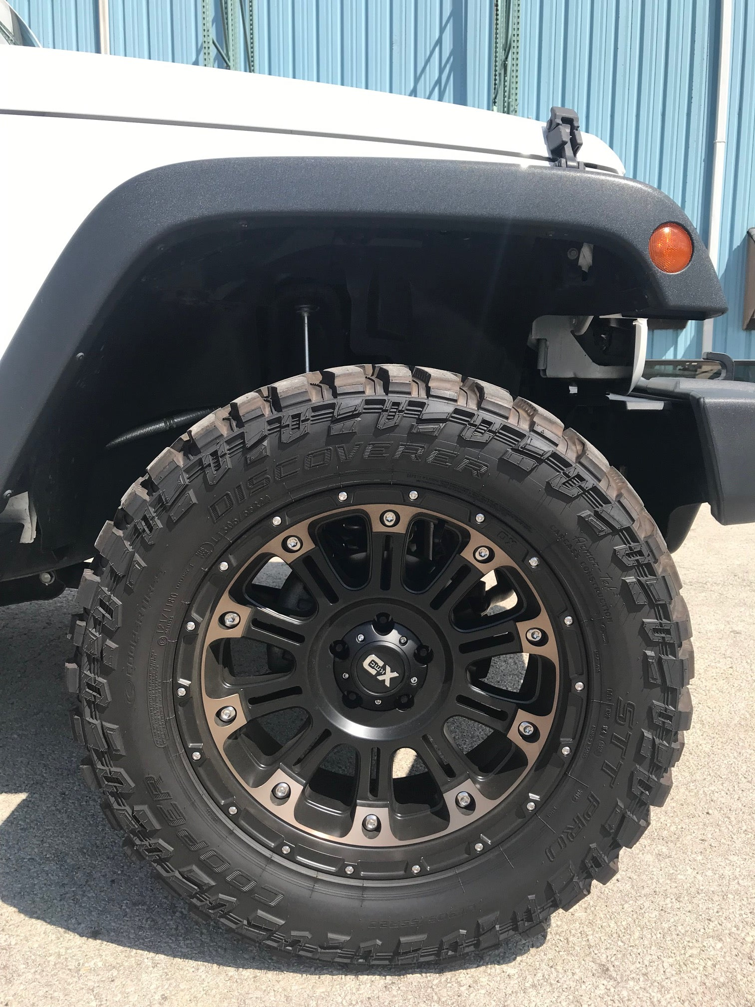 KMC XD Jeep Off Road Wheels Wrapped in Cooper Discovery STT Pro Tires