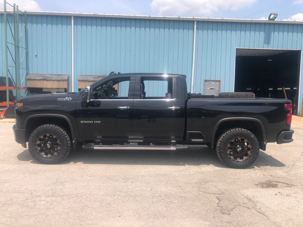Lifted Chevrolet Silverado 1500 High Country With KMC XD rims