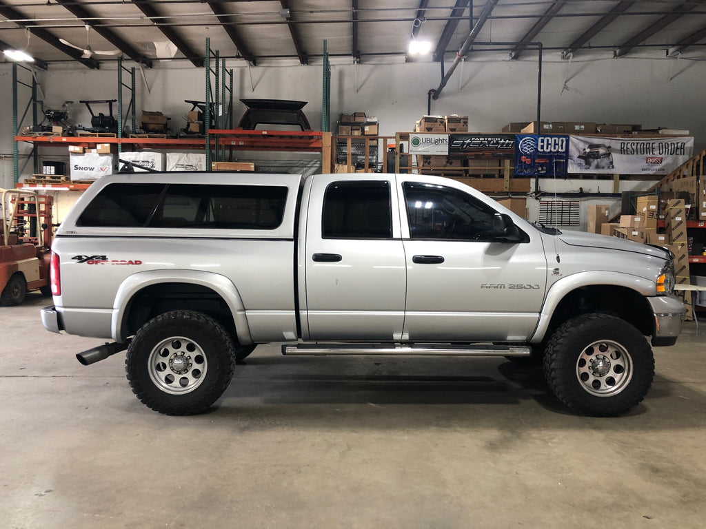 Lifted Ram 2500 with offroad tires and truck cap