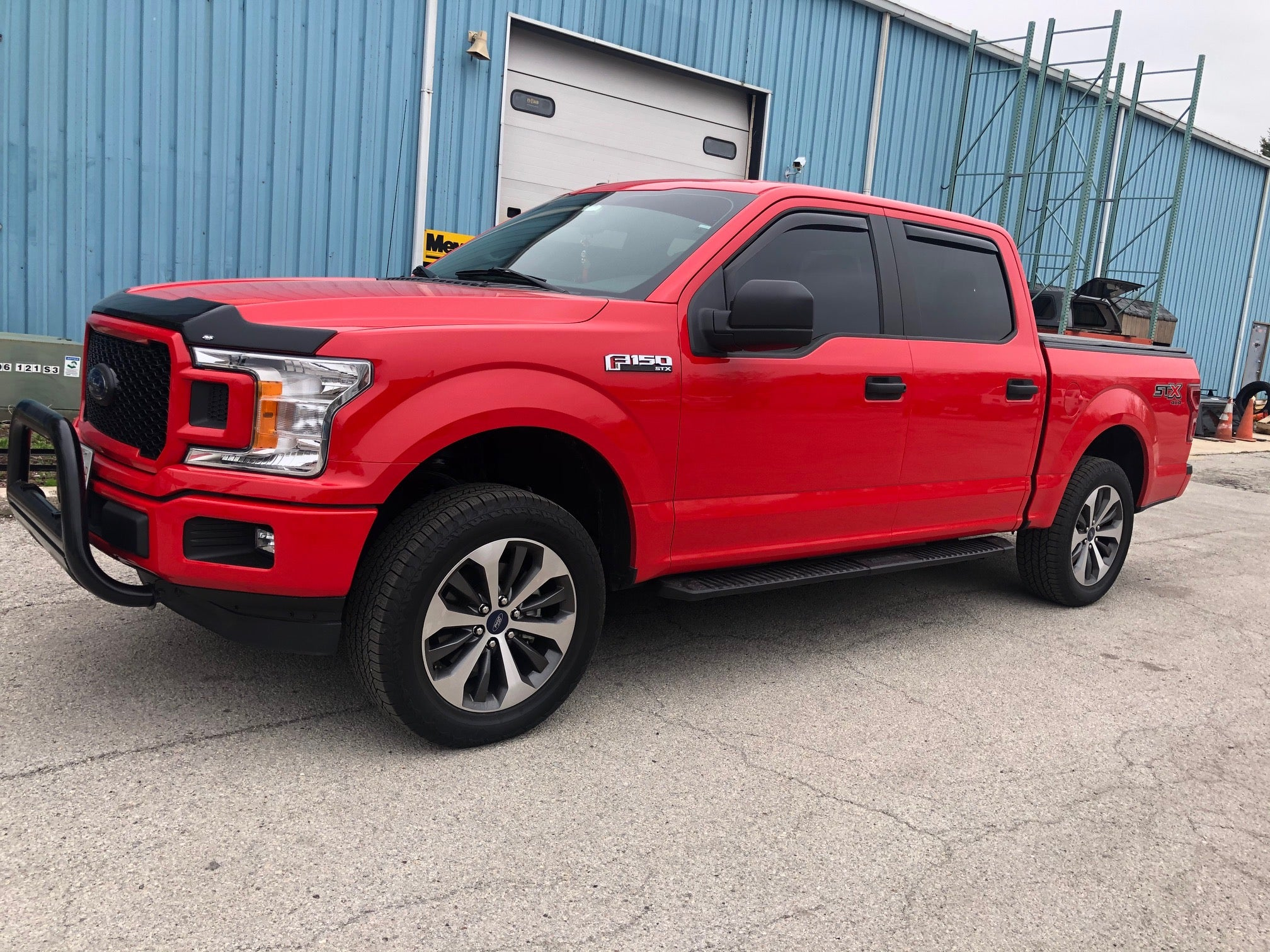 Red Ford F150 With Leveling Kit Installed at CPW Truck Stuff & Wheels