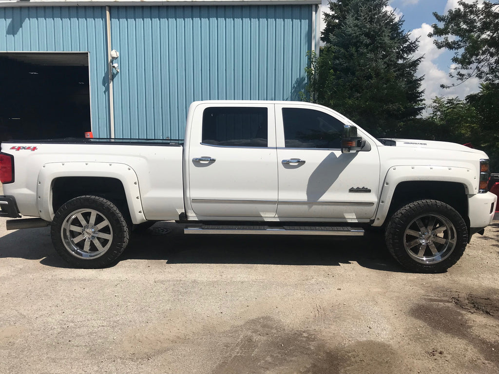 While Lifted Chevy Silverado High Country With Offroad Moto Metal Wheels & Offroad Tires