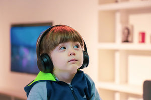 child listening to headphones without kids ear protection