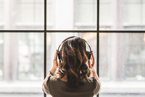 woman with tinnitus wearing headphones