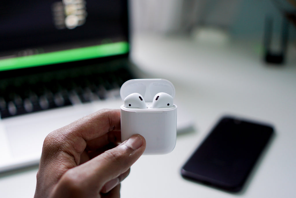 hand holding airpods